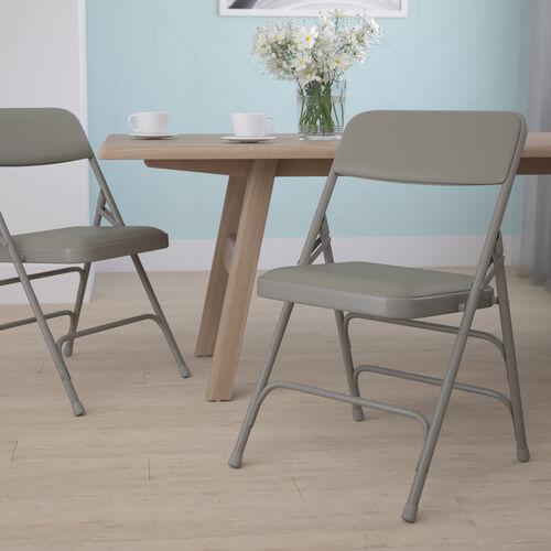 HERCULES Series Curved Triple Braced & Double Hinged Gray Vinyl Metal Folding Chair